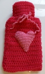 Pink hot water bottle